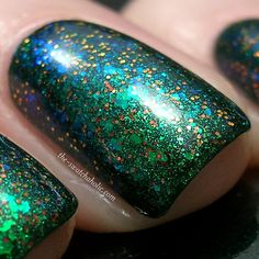 China Glaze – Glittering Garland: two  Nfu.Oh – 56: one  Ozotic Pro (Elytra) – 530: one  Base coat: OPI – Nail Envy Matte  Top Coat: Essence – Better Than Gel Nails Top Sealer