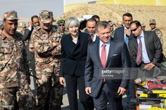 Theresa May, U.K. prime minister, center, and King Abdullah II of Jordan, right, inspect military equipment during a visit to a Jordanian Army Base in Zarqqa, Jordan, on Monday, April 3, 2017. May began a visit to Jordan and Saudi Arabia on Monday, with the goal of building security and commercial ties. Photographer: Simon Dawson/Bloomberg via Getty Images