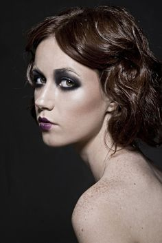 1920s makeup; heavy, smokey eyes with a heavy cupids bow lipstick