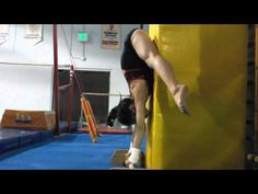 straddle handstand on bars