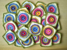 These crochet blocks are made up of four raised wheels, each worked in a different colour, within a square: free crochet pattern