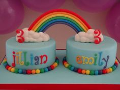 "rainbow - rainbow party for twin girls. berry blue jello mmf (search ""jello mmf"" in the recipes section) on cakes and board. mmf with tylose for rainbow and tappits numbers. mmf tappits names, clouds and ball borders. rainbow made with walnut hollow extruder."