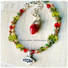 Animal Rights Vegan Bracelet  Hand stamped metal with the word Vegan in it.  Toho beads, czech glass beads.  Bracelet size is 16 cm plus a 4cm