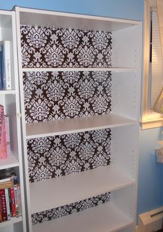 I revamped a boring shelf with wrapping paper!