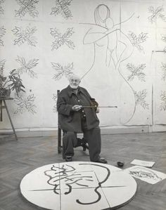 """Henri Matisse in his studio working with a sketch of """"The Virgin and Child""""for his chapel at Vence. France, 1950"""