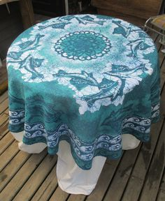 African Dolphins Dance on round Batik tablecloth on Polyester by goldphinbatik on Etsy Sell On Etsy, Outdoor Furniture, Outdoor Decor, Dolphins, Ottoman, African, Dance, Trending Outfits, Handmade Gifts