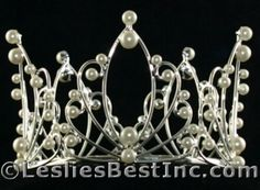 Image from http://www.ewholesaletiaras.com/mall/images/T/Pearl_Wedding_Brides_Bridal_Crown_Tiaras_Crowns_wm.jpg.