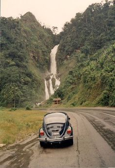 "In 1990 Pedro Delgado fulfilled a lifelong dream of driving the Pan-American Highway Picture here is in Ecuador, enjoying a stunning view of the Cascada de los Indios Colorados. ""The trip took me 68 days, of which 38 days were traveling, and 30 days were spent doing custom duties, some car maintenance, and the time spent in Colombia waiting for the ship that took my Volky [Volkswagen] from Colombia to Panama by ship,"""