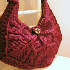 I like the shape of this bag - most of the patterns I see for knitted bags are rectangular. Love the lotus pattern too.