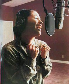 Selena,singing n recording her songs at the studio