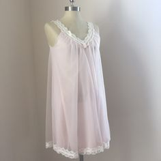 Vanity Fair Nighty Lovely pink and cream lace baby doll nighty by Vanity Fair  I bought this from a Vintage boutique and never wore it, it is in great vintage condition and has most likely been worn in the past, I will launder again before sending  it is very clean! Lovely girly piece  fits like a women's small I would any size up to 34D (my size)    No trades No ️aypal Merc ✅Posh Rules ✅Use Offer Button ✅Bundle for 15% off  Instagram @BeThriftyChic Vanity Fair Intimates & Sleepwear Chemises…