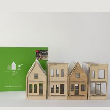 The front of the Little Huset Small City houses are made of wood and the wall surfaces of recycled paperboard. They're meant to be drawn on. The packaging is also a play surface, printed to unfold and become a little city map to color on and explore making your very own city.
