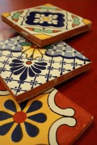 DIY coasters... pick out a few tiles that you L-O-V-E, then purchase pre-cut cork board in 6 inch squares and gorilla glue it.  A-MAZ-ING