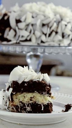 Recipe with video instructions: When you combine two delicious things in dessert form, you get beautiful results. Ingredients: 4 eggs, 1 cup sugar, 1/4 cup olive oil, 1 cup flour, 1 pinch of salt, 1 1/2 cups powdered chocolate, 1/2 cup boiling water, 1/2 teaspoon vanilla extract, 1 1/2 teaspoon baking soda, 2 cans (790 grams sweetened condensed milk), 50 grams butter, 200 grams dry coconut flakes, 100 milliliters coconut milk, 300 grams chocolate ganache, 250 grams co...