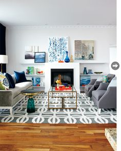 asymmetrical - long couch on the left side and two chairs on right to make it even out , two different size picture frames on the wall on the right side to even out the one on the left side wall