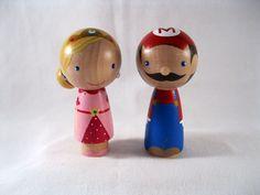 Super Mario Princess Peach a Video game romance Kokeshi Peg Doll Couple Wedding Cake topper or Ornament.  via Etsy.