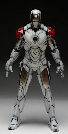 Iron Man Mark IV. I can't verify from a picture if this were real but if it were, it's the best Iron Man cosplay i've ever seen. And if not, here's inspiration for someone to aspire to with the details.