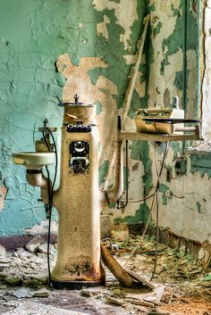 abandoned but I remember spit sinks next to the patient's chair in a dental office.