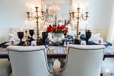 Gothic Halloween table idea with brass and gold candelabras as the centerpiece