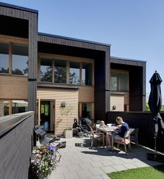 Prästgården housing by Arkitema Architects in Gustavsberg, Sweden, with blackened wood cladding on the edge of a rocky precipice. Residential Architecture, Contemporary Architecture, Architecture Details, Classical Architecture, Ancient Architecture, Sustainable Architecture, Landscape Architecture, Duplex Design, Townhouse Designs