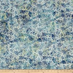 Designed for South Sea Imports, this Indonesian batik fabric is perfect for quilting, apparel and home decor accents. Colors include shades of blue and grey.