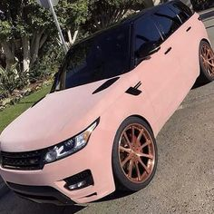Pink velvet range rover with rose gold wheels
