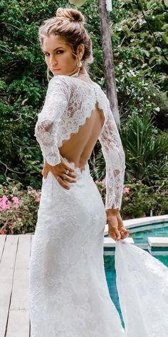 30 Best Lace Wedding Dresses With Sleeves Women's lace wedding dresses with sleeves is considered to be one of the most relevant models this season.Lace wedding dress is stylish at all times. Bella Swan Wedding Dress, Wedding Dress Mermaid Lace, Lace Bridal, Lace Wedding Dress With Sleeves, Open Back Wedding Dress, Long Wedding Dresses, Long Sleeve Wedding, Mermaid Dresses, Bridal Dresses