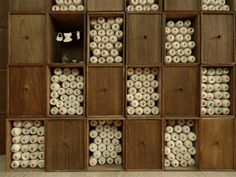 Traditional style bookcase for scholar filled with handmade thread spools.