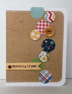 Cute card. Scattered scrap circles, some raised; pen stitch lines; button one of the circles; banner with eyelet