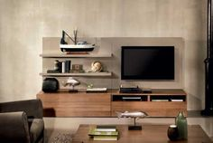 We design sofas, furniture and accessories for the living and dining areas and the bedroom,and we build them entirely in Italy. Tv Unit Design, Living Room Tv, Wall Units, Home Remodeling, Kitchen Remodel, Architecture Design, Family Room, Sweet Home, Design Inspiration