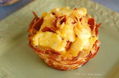 Scrambled eggs in hash brown nests... easter breakfast, maybe??