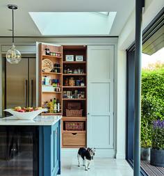 Hidden pantry storage in our Hartford Blue Shaker Kitchen