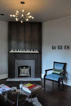 ebony stained maple veneer fireplace surround, sputnik, cowhide, living room