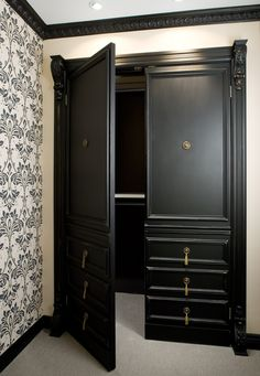 Trim, paint and hardware convert plain closet doors to look like dramatic armoire. Same treatment as other dressers in room is soothing and cohesive in this small space.