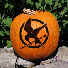 13 Ideas to Take Your Pumpkins from Drab to Fab...There are just some movie symbols that are common knowledge, like Superman or Captain America or Hunger Games. Make fellow fans smile with your favorite symbol glowing brightly on a pumpkin.