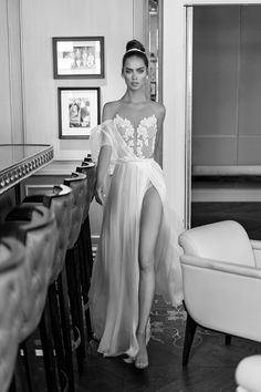 A Flowing Bridal Gown From Elihav Sasson's 2017 Collection With Sky High Slits To Show Off Your Legs As You Walk Down The Aisle. | WedLuxe Magazine | #wedding #luxury #weddinginspiration #bridetobe #weddinggown #weddingdress #gown #elihavsasson #fashion #style