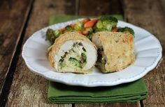 Pesto, cheese and sundried tomatoes, all rolled up in breaded chicken breasts make these tasty Pesto Chicken Roulades. Only 331 calories or 7 Weight Watchers SmartPoints each! www.emilybites.com