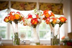 Orange and white wedding flowers. Erin and Dan's outdoor wedding at Lenora's Legacy. Image credit: Famzing.