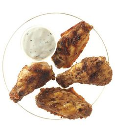 Grilled Spiced Chicken Wings recipe: Give chicken wings an unexpected twist with seafood seasoning; creamy ranch dipping sauce adds a deliciously rich element.