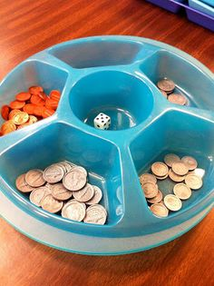 This game is VERY simple but powerful for the kids  because it helps them to make those connections that 5 pennies = 1 nickel,  2 nickels = 1 dime, etc...