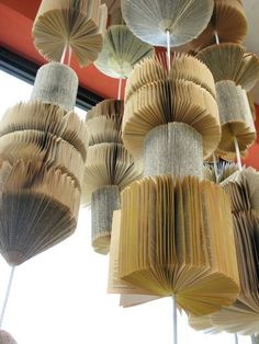 inspiration from Anthropologie- old books strung together and glued from cover to cover to make a cylinder...