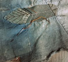 spirit cloth, clothing, upcycle, upcycled, feather, mixed meda, stitch, art, artist, stitching on fabric, inspiration, hand stitching, textile art, textile artist, Jude Hill, Spirit Cloth