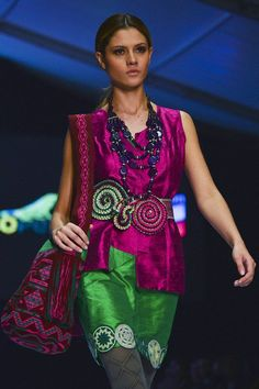 A model displays a creation by the designers collective Wayuu during the Bogota Fashion Week, in the Colombian capital, on May 9, 2013.
