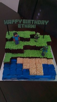 Minecraft birthday cake... My cousins name is Ethan and he loves minecraft just like me... So funny...
