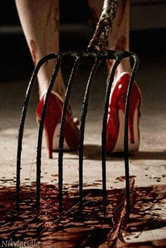 Bloodied heels and a dripping pitchfork. ''Not the way I wanted to finish him off, but did you really have to rush me like this, Andy?'' Rebecka grunts while frowning at her dirtied heels. ''Who thought he would try to run away? It's not every day we doll up to do our jobs.''   (1/2)