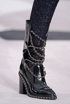 Chanel, inspiration. Could do cut outs on the front panel of suede boots to mimic the leather strips across the front, add tabs for the chain. could spray with a gloss sealant for the high shine look. or glitterrrrrr.