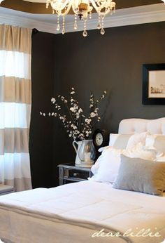 Love this bedroom. The dark walls with the light bedding actually looks cozy.