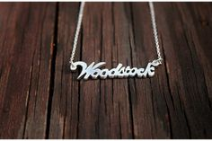 Silver suburb name tag necklace.Represent your 'hood' with a custom handsawn silver suburb necklace. Mirror Jewelry Armoire, Name Tags, Jewelry Branding, Jewelry Box, Jewellery, Arrow Necklace, Names, Rings, Pretty