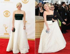 "Black and white has never looked better. ""Mad Men"" star Elisabeth Moss put her own chic twist on a classic color combo by pairing her princess dress with a bold red lip and her edgy blond pixie cut."