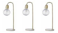 Woonvondst: gouden lamp met marmeren voet